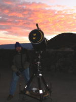 Andrew setting up a telescope at sunset in preparation for the public program on at the VIS on Mauna Kea.