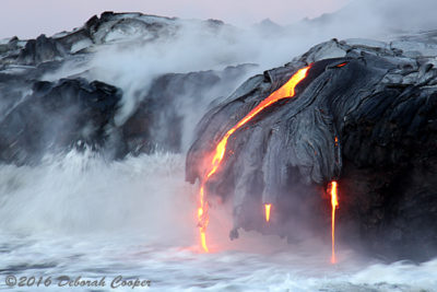 Lava appears to have been reaching for the Ocean in among the steam and burbling water.